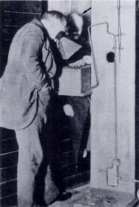 Dally (arrow) undergoes fluoroscopy by Thomas Edison.