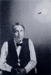 Thomas Edison photographed with his X-ray tube fluorescent lamp (arrow).