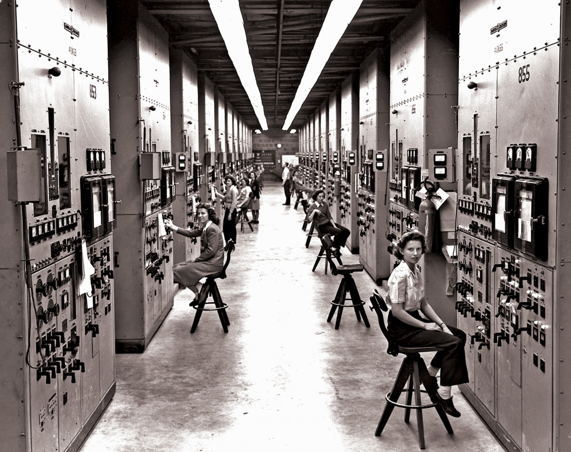 This photograph of the Calutron technicians is one of the most famous photographs from Oak Ridge and Gladys Owens is the technician closest to the camera.