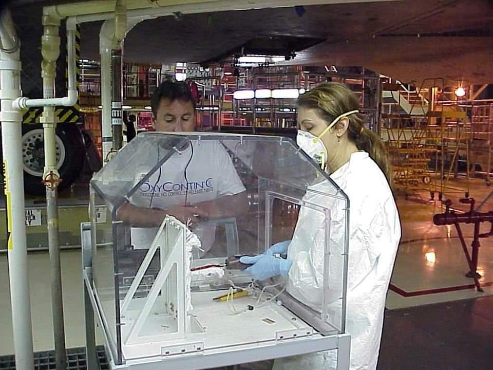 Eva performing mechanical tests on the bonding material used to attach the flexible insulation blankets to the Shuttle.