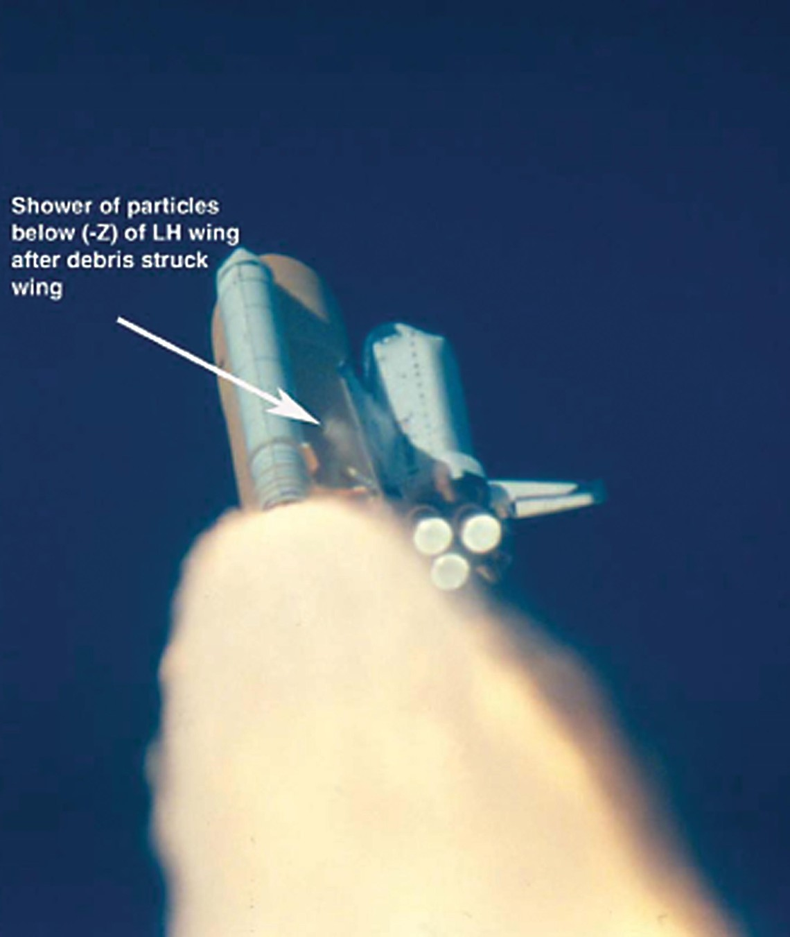 Approximately 33 seconds after liftoff of Space Shuttle Columbia, several particles are observed falling away from the solid rocket booster. These went on to damage the thermal protection system on the wing. (Image credit: NASA)